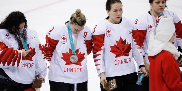 Canada's Jocelyne Larocque, second from right, holds her silver medal after losing to the U.S in the...