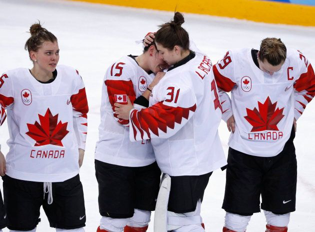 Team Canada players react after losing the women's hockey gold medal game against the U.S. at the Winter...