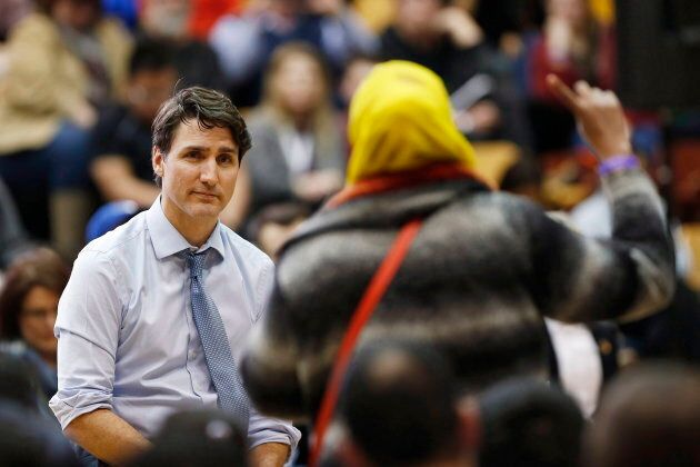 Prime Minister Justin Trudeau listens to a question about Child and Family Services at a town hall meeting...