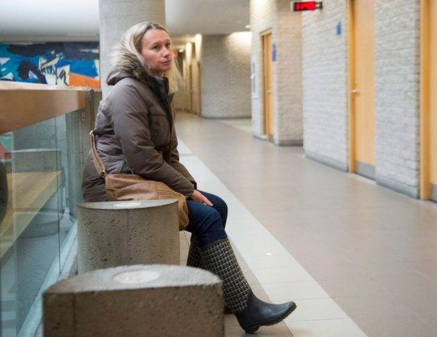Magdalena Biron waits outside a courtroom on