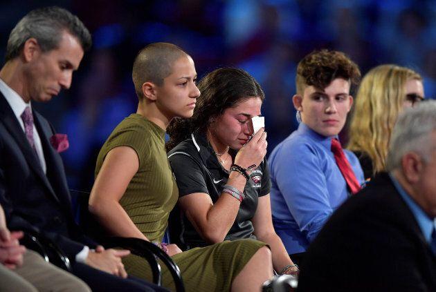 Marjory Stoneman Douglas High School student Emma Gonzalez comforts a classmate during a CNN town hall...