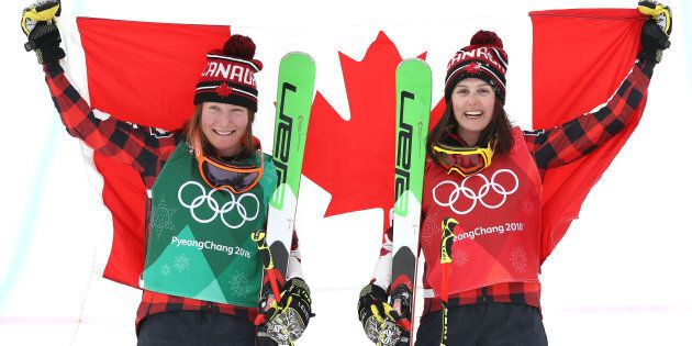 Kelsey Serwa, right, celebrates her gold medal win in women's skicross with silver medallist and teammate...