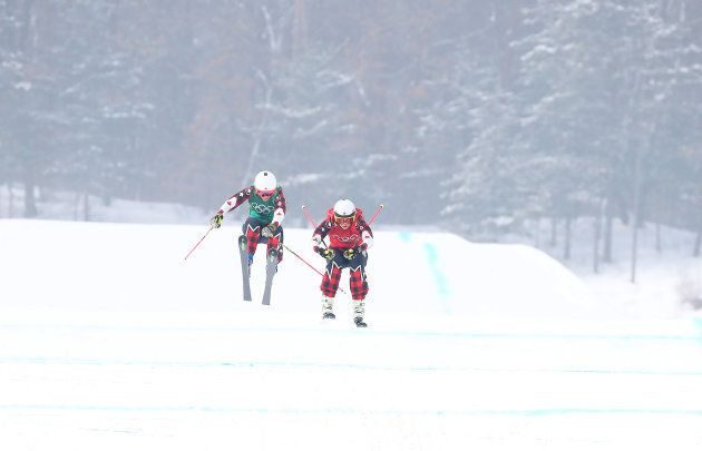 Canada's Brittany Phelan, left, and Kelsey Serwa race in the women's skicross