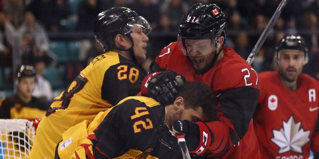 Canada's Cody Goloubef collides with Germany's Yasin Ehliz. Canada lost its semifinal game against Germany...