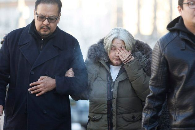 Thelma Favel, centre, Tina Fontaine's great-aunt and the woman who raised her, weeps as she enters the...