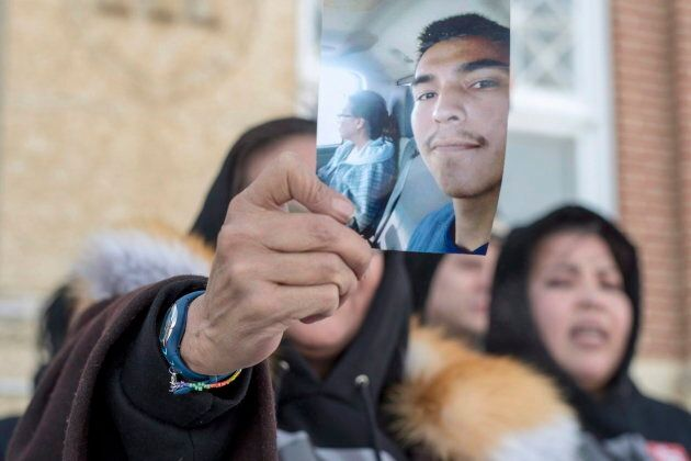 Debbie Baptiste, the mother of Colten Boushie, holds up a picture of her son.