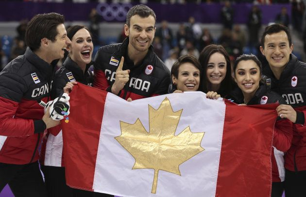 Team Canada celebrates their gold medal win in the figure skating team event at the PyeongChang Olympics...