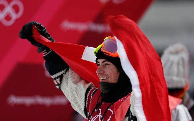 Canada's Sebastien Toutant celebrates winning the gold medal during the men's big air
