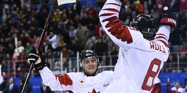 Canada's Wojciech Wolski, right celebrates scoring in the men's bronze medal hockey game. Canada would...