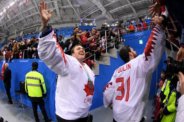 Goalies Ben Scrivens #30 and Kevin Poulin #31 of Canada celebrate with fans after defeating Czech Republic