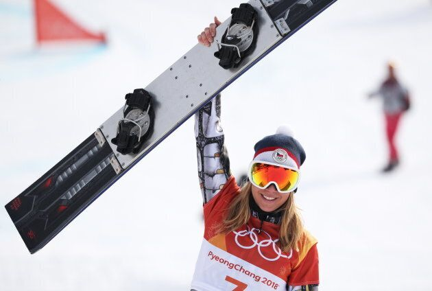The Czech Republic's Ester Ledecka celebrates as she wins gold in the ladies' snowboard parallel giant