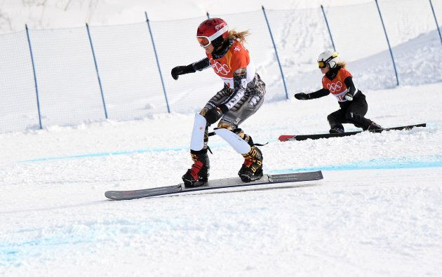 Ester Ledecka of the Czech Republic, front, races against Selina Jorg of Germany in the snowboard parallel...