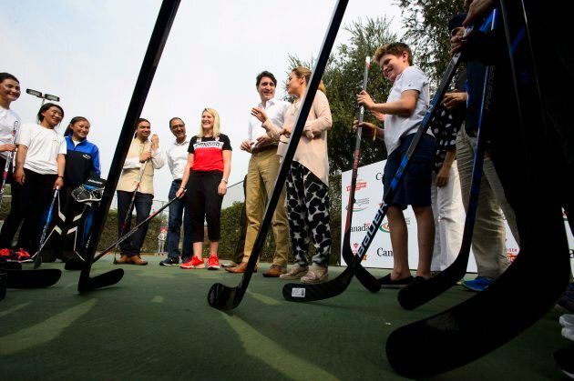 Prime Minister Justin Trudeau, wife, Sophie Gregoire Trudeau and son Xavier take part in a hockey event...