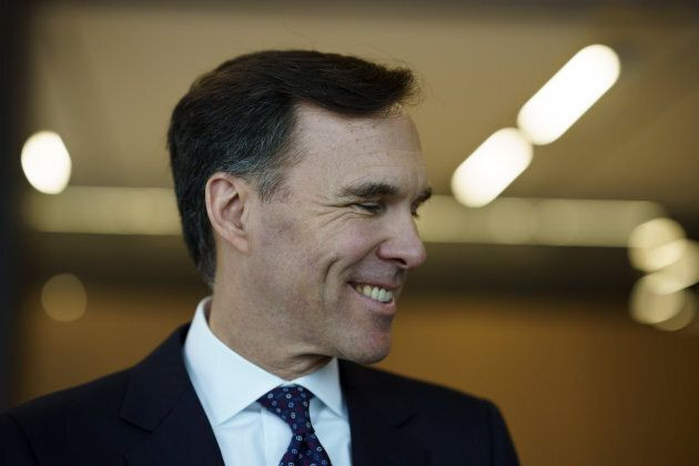 Bill Morneau, Canada's finance minister, smiles while speaking to members of the media on Jan. 18,