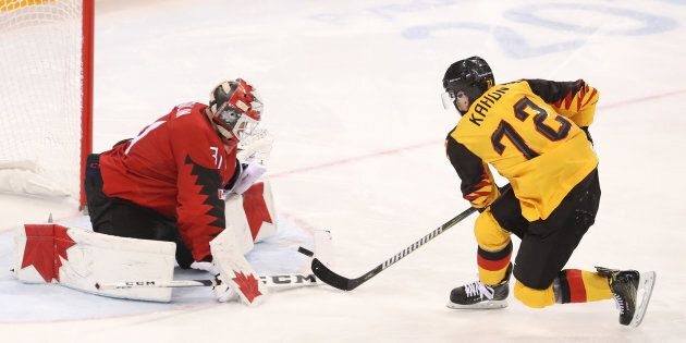 Kevin Poulin of Canada stops a penalty shot by Dominik Kahun of Germany during the Men's Play-offs Semifinals...