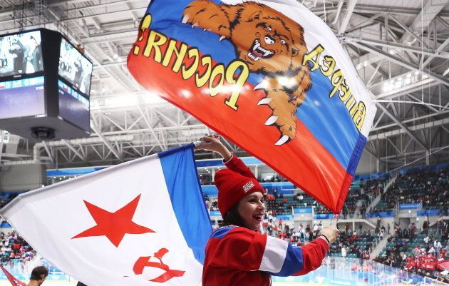 Russian fans cheer during a men's hockey game in