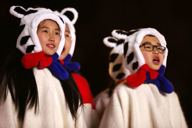 Children sing during the Closing Ceremony of the PyeongChang 2018 Winter Olympic Games.
