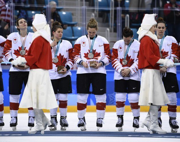 Canada's women's team wins silver. Canada's hockey and curling teams did not defend their Olympic titles...