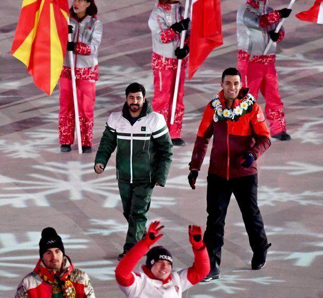 Pakistan's Muhammad Karim (L) and Tonga's Pita Taufatofua are photographed during the closing ceremony...