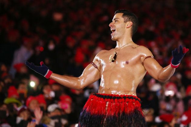 Tonga's Flag-Bearer, Pita Taufatofua, Enters Closing Ceremony In Clothes, Then Takes Them