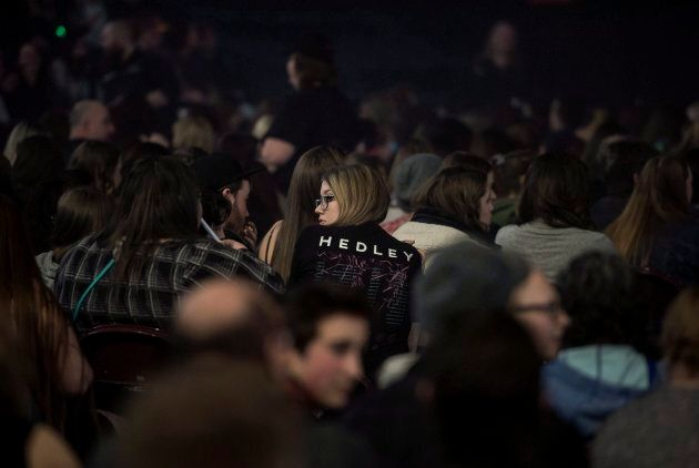 A fan wearing a t-shirt for the rock group Hedley sits in the crowd before the band's concert in Halifax...