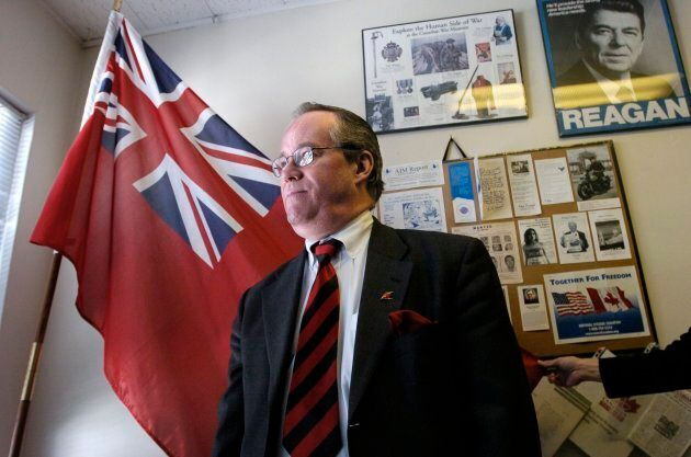 Paul Fromm poses in front of an Ontario flag in 2005. He's been linked to neo-Nazi groups in Canada and...