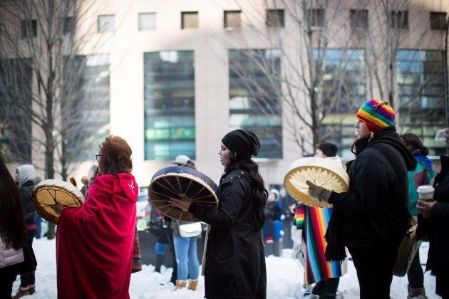 Women sing and drum during a rally for Tina Fontaine in Vancouver on