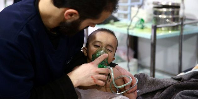 A man and a child are seen in a hospital in the besieged town of Douma, Eastern Ghouta, Damascus, Syria...