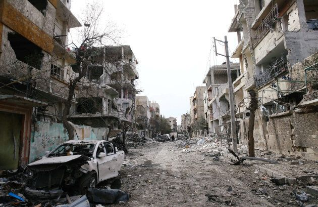 Damaged cars and buildings are seen in the besieged town of Douma, Eastern Ghouta, Damascus, Syria on...