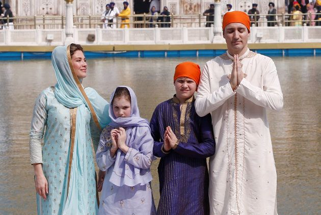 Canadian Prime Minister Justin Trudeau, his wife Sophie Gregoire, daughter Ella Grace and son Xavier pose for photographers during their visit to the holy Sikh shrine of Golden temple in Amritsar, India on Feb. 21, 2018.