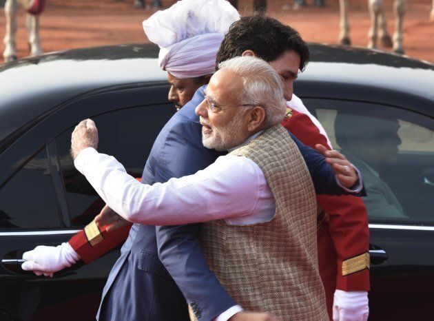 Canadian Prime Minister Justin Trudeau hugs PM Narendra Modi at the ceremonial reception at Rashtrapati Bhawan on Feb. 23, 2018 in New Delhi, India.