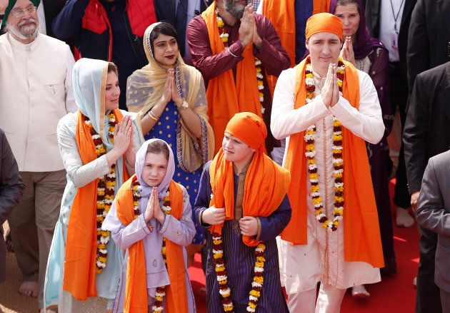 Canadian Prime Minister Justin Trudeau with his wife Sophie Gregoire, daughter Ella Grace and son Xavier greet the people during their visit to the holy Sikh shrine of Golden temple in Amritsar, India on Feb. 21, 2018.