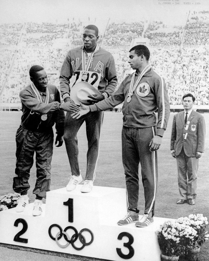 Harry Jerome (right) celebrates his bronze medal win in the 100m athletics event at the 1964 Tokyo Olympics.