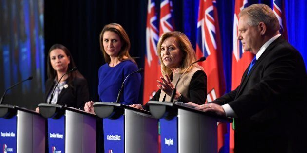 Ontario PC leadership candidate Christine Elliott speaks as candidates Tanya Granic Allen, left, Caroline Mulroney and Doug Ford participate in a debate in Ottawa on Wednesday.
