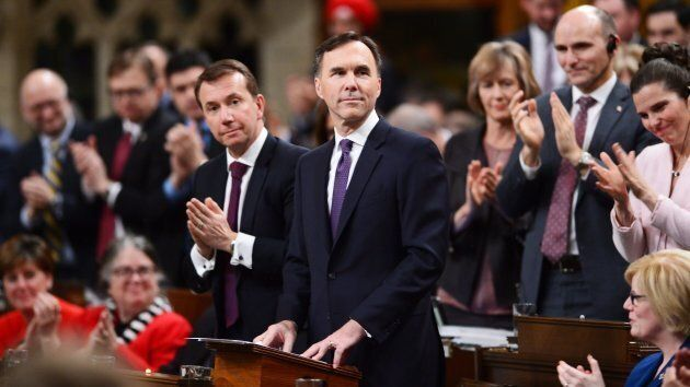 Finance Minister Bill Morneau receives an ovation after delivering the federal budget in the House of...