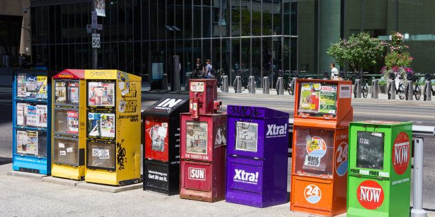 Various newspaper boxes line a street in Toronto. The 2018 Liberal budget pledges $50 million over five...