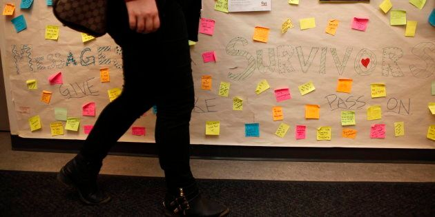 A sign created by students as part of an anti-violence project, following an assault on campus, contains messages of support at the University of Victoria in B.C. on March 4, 2016.