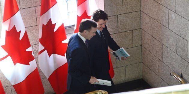 Finance Minister Bill Morneau, left, and Prime Minister Justin Trudeau leave the prime minister's office...