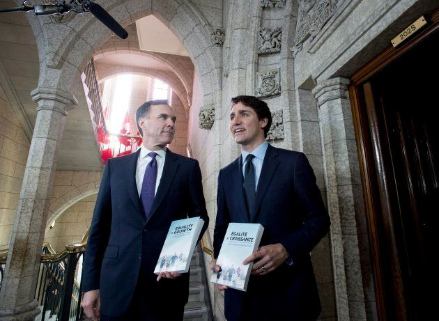 Minister of Finance Bill Morneau walks with Prime Minister Justin Trudeau before tabling the federal...