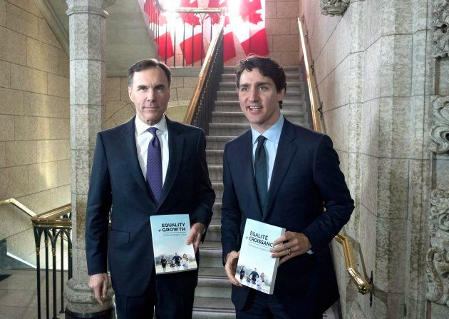 Minister of Finance Bill Morneau walks with Prime Minister Justin Trudeau before tabling the budget in...