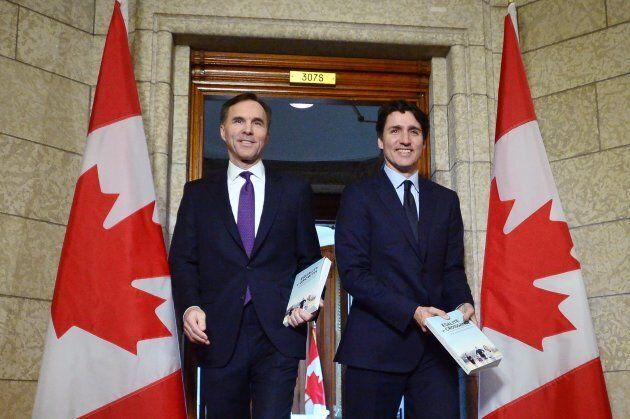 Finance Minister Bill Morneau and Prime Minister Justin Trudeau leave the prime minister's office to...