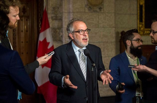 Former Bloc Quebecois MP Rheal Fortin speaks to reporters in the foyer of the House of Commons on Feb. 28, 2018.
