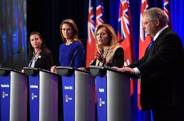 Ontario PC leadership candidate Christine Elliott speaks as candidates Tanya Granic Allen, left, Caroline...