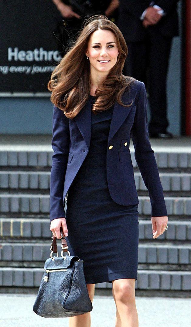The Duchess of Cambridge wearing a Smythe blazer at Heathrow airport.