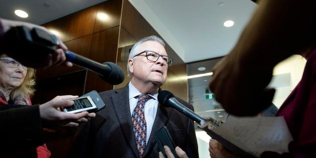 Public Safety Minister Ralph Goodale speaks to reporters as he arrives to appear before the Standing...