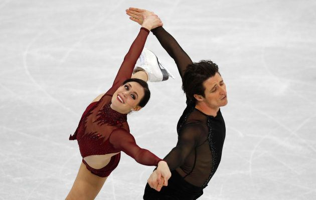 Tessa Virtue skates for her life and still looks red carpet-worthy when she and Scott Moir perform in...