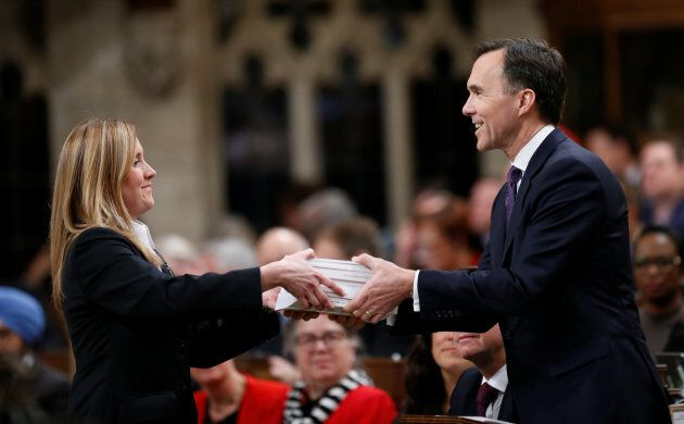Finance Minister Bill Morneau, right, tables the 2018 federal budget in the House of Commons on Parliament...