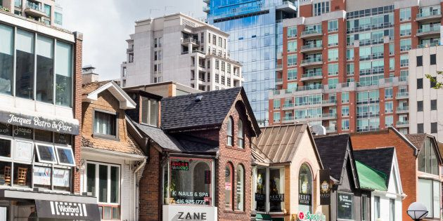 Buildings on Cumberland Street in Toronto's Yorkville neighbourhood, with condo towers in the background. The once-unstoppable juggernaut that was Greater Toronto's housing market has slowed to a crawl.