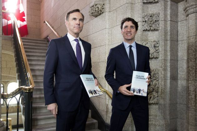 Prime Minister Justin Trudeau, right, and Finance Minister Bill Morneau, left, arrive at the House of...