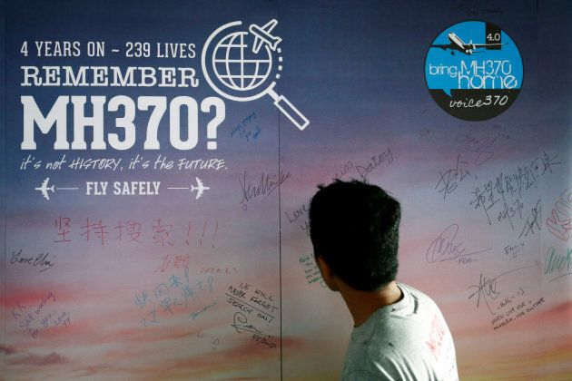 A man looks at a message board for passengers, onboard the missing Malaysia Airlines Flight MH370, during...